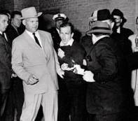 http://lisawallerrogers.files.wordpress.com/2009/09/lee-harvey-oswald-shot-by-jack-ruby-in-the-basement-of-the-dallas-police-department-sunday-november-24-1963-2-days-after-the-kennedy-assassination.jpg?w=468&h=411